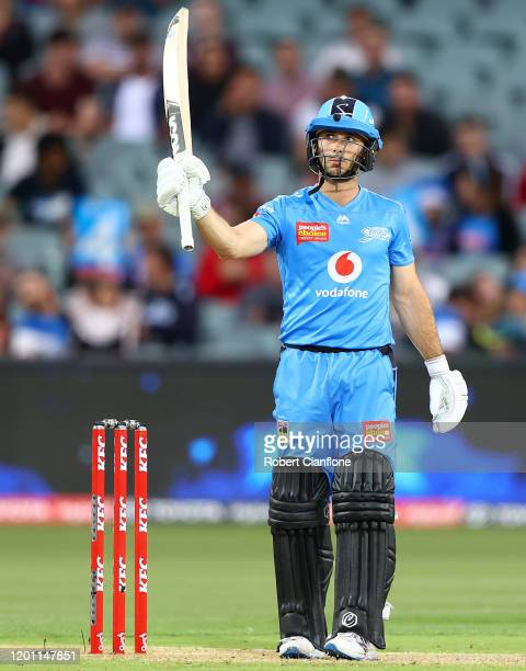 Jonathan Wells of the Strikers celebrates after scoring his fifty runs during the Big Bash League match between the Adelaide Strikers and the...