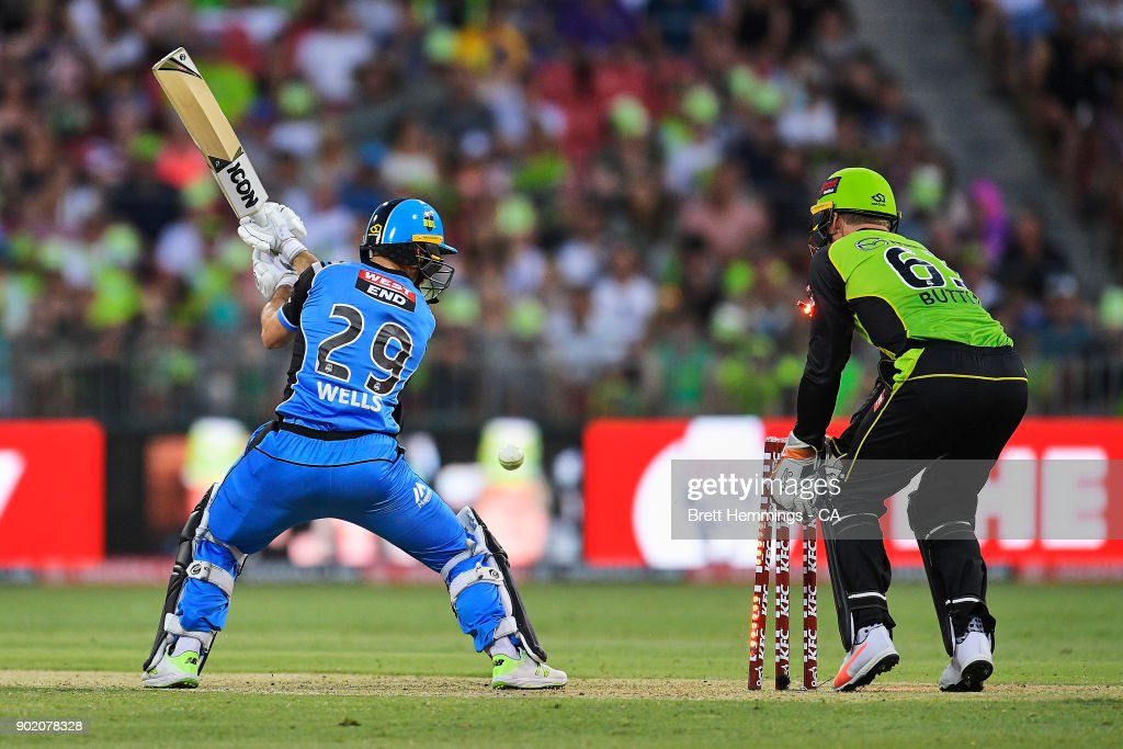 Jonathan Wells of the Strikers is bowled out by Fawad Ahmed of the Thunder during the Big Bash League match between the Sydney Thunder and the Adelaide Strikers at Spotless Stadium on January 7, 2018 in Sydney, Australia.