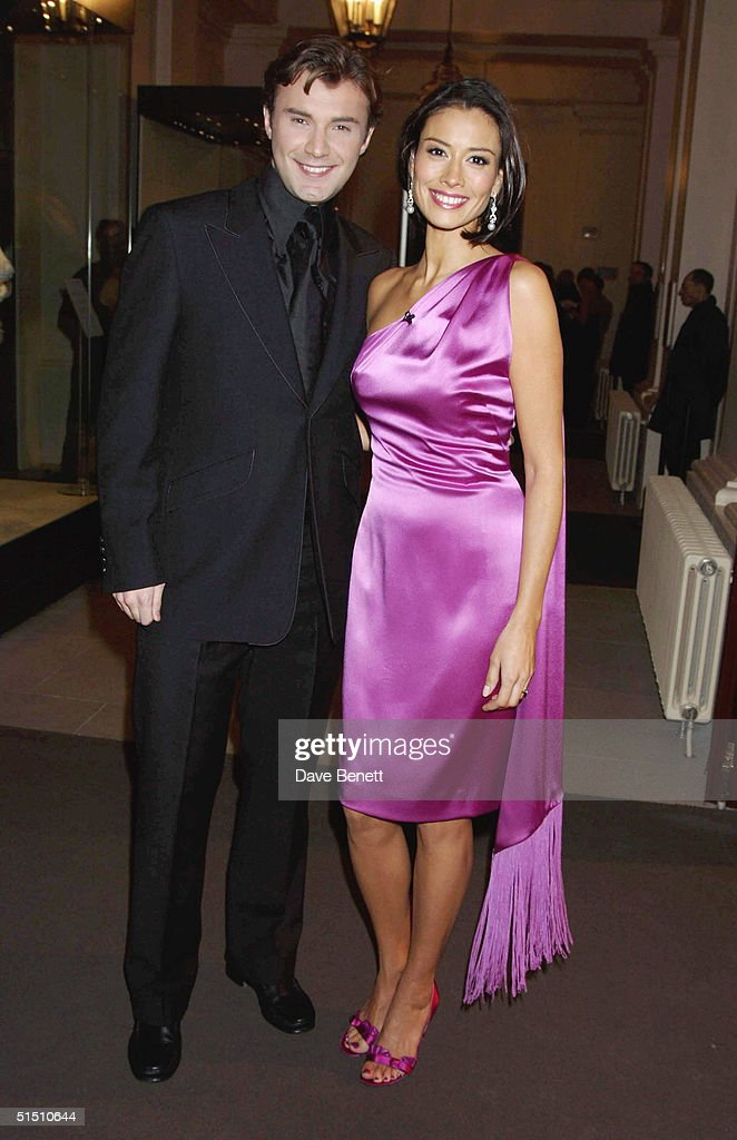 Jonathan Wilkes and Melanie Sykes attend the 2003 National TV Christmas Party at The Royal Opera House in Covent Garden on December 8, 2003 in London.