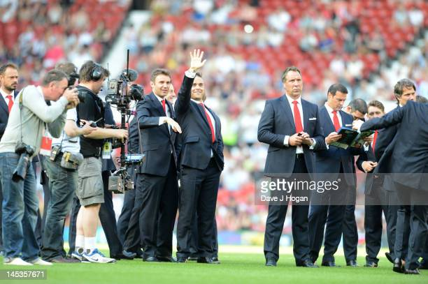 Jonathan Wilkes, Robbie Williams and David Seaman attend Soccer Aid 2012 in aid of Unicef at Old Trafford on May 27, 2012 in Manchester, England.
