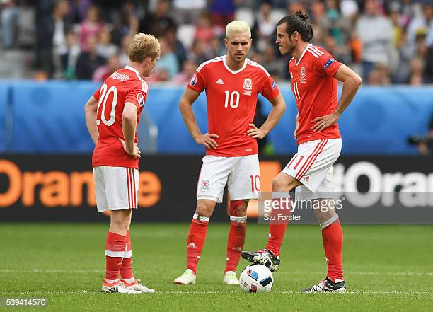Jonathan Williams Aaron Ramsey and Gareth Bale of Wales show their dejection after Slovakia's first goal during the UEFA EURO 2016 Group B match...