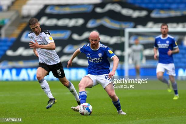 Jonathan Williams of Cardiff City FC and Lewis Wing of Rotherham United during the Sky Bet Championship match between Cardiff City and Rotherham...