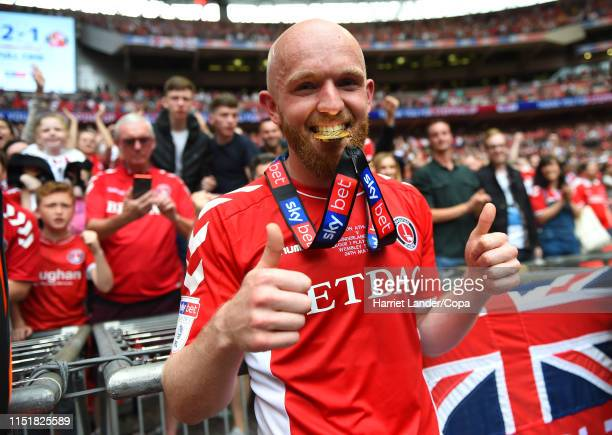 Jonathan Williams of Charlton Athletic celebrates with his Sky Bet League One Playoff Final Winners Medal following his team's victory in the Sky Bet...