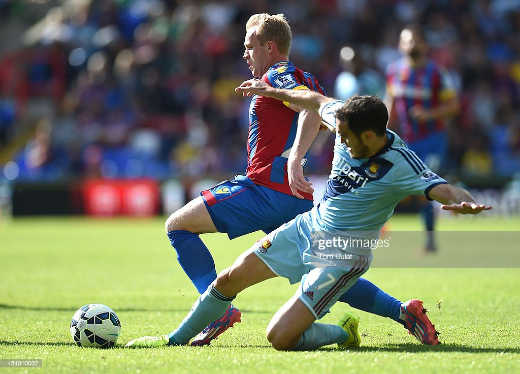 Jonathan Williams of Crystal Palace and Joey O'Brien of West Ham battle for the ball during the Premiere League match between Crystal Palace and West Ham United at Selhurst Park on August 23, 2014 in London, England.