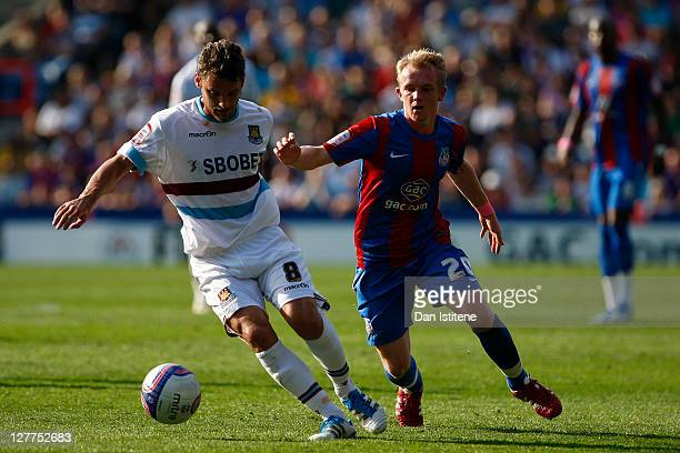 Jonathan Williams of Crystal Palace in action against David Bentley of West Ham during the npower Championship match between Crystal Palace and West...