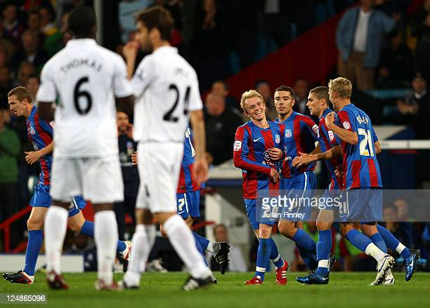 Jonathan Williams of Palace is congratulated by his team mates after scoring the seconf goal during the Carling Cup second round match between...