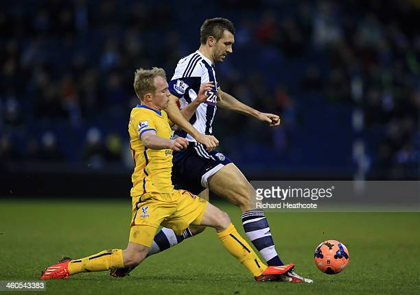Jonathan Williams of Palace tackles Gareth McAuley of West Brom during the Budweiser FA Cup third round match between West Bromwich Albion and...