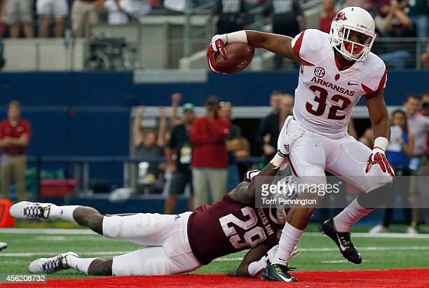 Jonathan Williams of the Arkansas Razorbacks carries the ball into the end zone to score against Deshazor Everett of the Texas A&M Aggies in the...