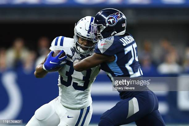 Jonathan Williams of the Indianapolis Colts is pursued by Adoree' Jackson of the Tennessee Titans during the first quarter at Lucas Oil Stadium on...