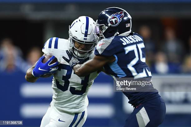 Jonathan Williams of the Indianapolis Colts is pursued by Adoree' Jackson of the Tennessee Titans during a game at Lucas Oil Stadium on December 01...
