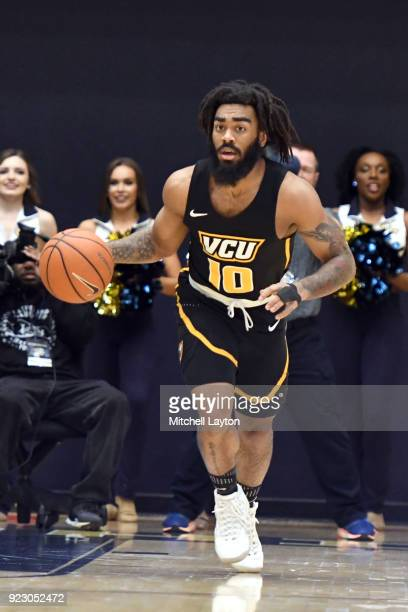 Jonathan Williams of the Virginia Commonwealth Rams dribbles up court during a college basketball game against the George Washington Colonials at the...