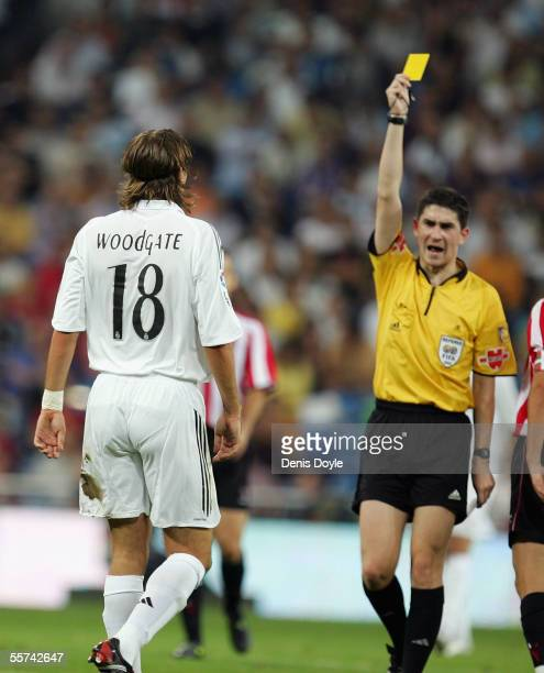 Jonathan Woodgate of Real Madrid gets a yellow card during the Primera Liga soccer match between Real Madrid and Athletic Bilbao at the Bernabeu on...