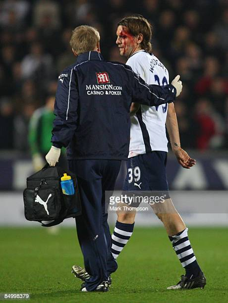 Jonathan Woodgate of Tottenham Hotspur leaves the field after sustaining a cut during the Barclays Premier League match between Hull City and...