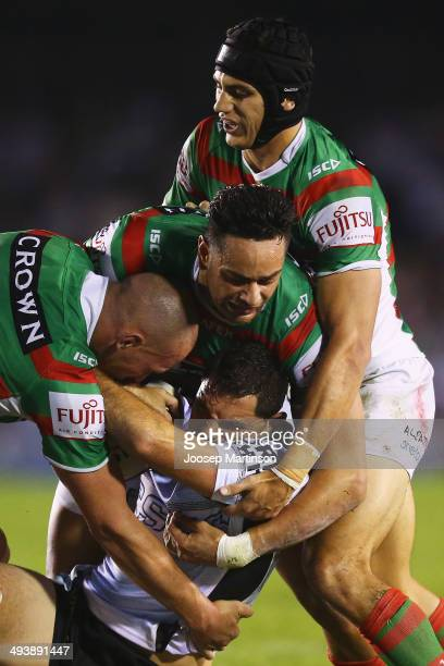 Jonathan Wright of the Sharks is tackled during the round 11 NRL match between the Cronulla-Sutherland Sharks and the South Sydney Rabbitohs at...