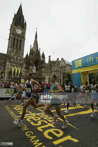 Jonathan Wyatt of New Zealand and Andrew Letherby of Australia during the Start of the men's Marathon at Albert Square during the 2002 Commonwealth...