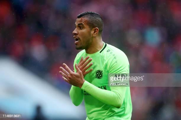 Jonathas de Jesus of Hannover 96 reacts after receiving a second yellow card during the Bundesliga match between FC Bayern Muenchen and Hannover 96...