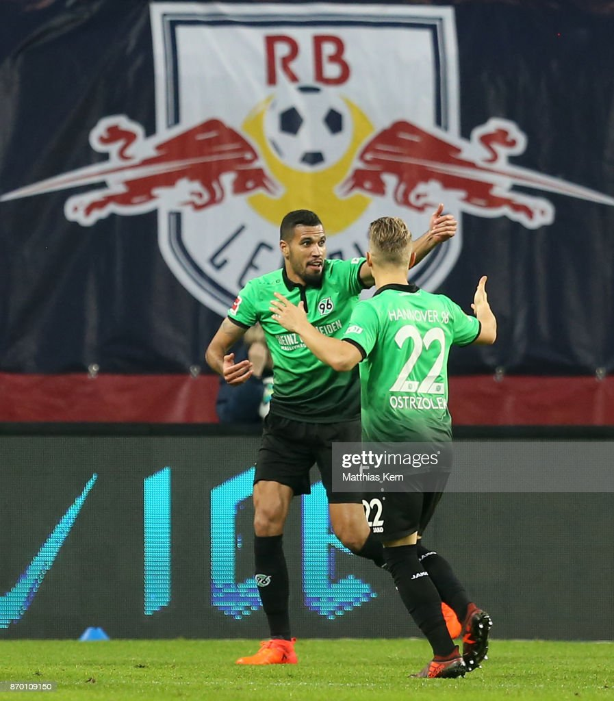 Jonathas de Jesus (L) of Hannover jubilates after scoring the first goal during the Bundesliga match between RB Leipzig and Hannover 96 at Red Bull Arena on November 4, 2017 in Leipzig, Germany.