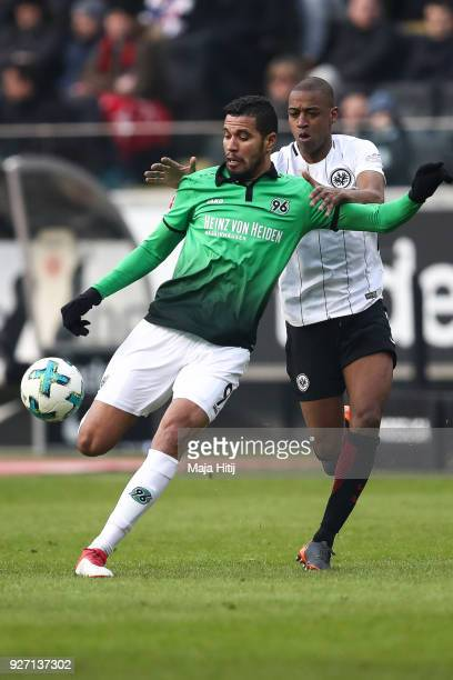 Jonathas of Hannover 96 and Gelson Fernandes of Eintracht Frankfurt battle for the ball during the Bundesliga match between Eintracht Frankfurt and...