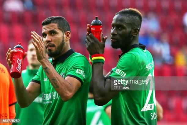Jonathas of Hannover and Salif Sane of Hannover looks on during the Bundesliga match between FC Augsburg and Hannover 96 at WWKArena on October 21...