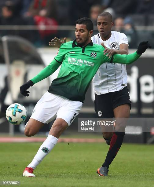 Jonathas of Hannover fights for the ball with Gelson Fernandes of Frankfurt during the Bundesliga match between Eintracht Frankfurt and Hannover 96...
