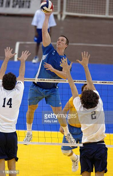 Jonathon Acosta of UCLA goes up for a kill between Keith Kowal and Dan O'Dell of Penn State during 30-20, 30-24, 30-27 victory in NCAA men's...