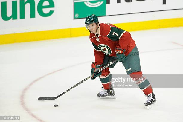 Jonathon Blum of the Minnesota Wild controls the puck during the preseason game against the Columbus Blue Jackets on September 17 2013 at Xcel Energy...