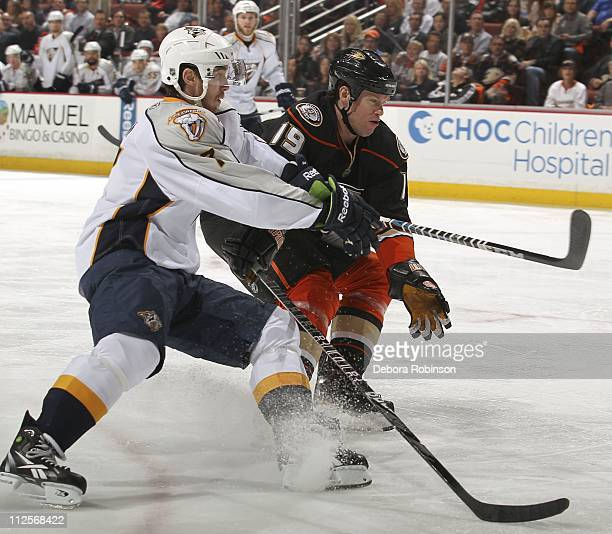Jonathon Blum of the Nashville Predators and Brad Winchester of the Anaheim Ducks battle for position in Game Two of the Western Conference...