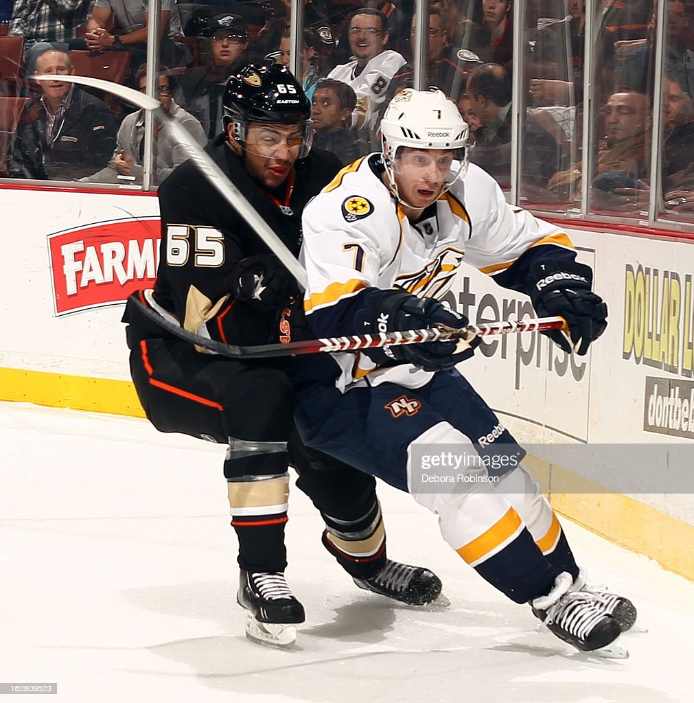 Jonathon Blum #7 of the Nashville Predators battles for position against Emerson Etem #65 of the Anaheim Ducks on February 27, 2013 at Honda Center in Anaheim, California.