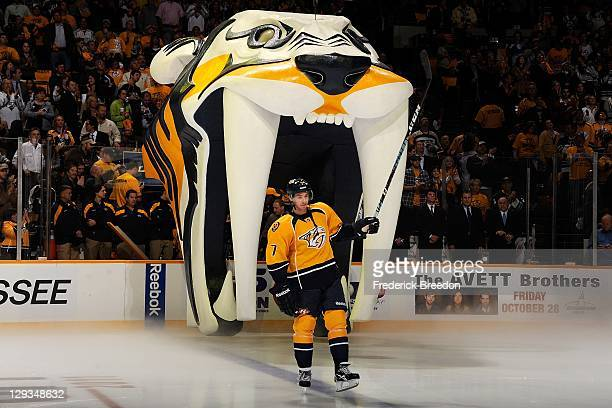 Jonathon Blum of the Nashville Predators skates out onto the ice during introductions prior to a game against the Phoenix Coyotes at the Bridgestone...
