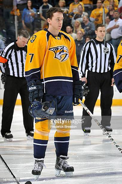 Jonathon Blum of the Nashville Predators stands during the national anthem prior to a game against the Calgary Flames at the Bridgestone Arena on...