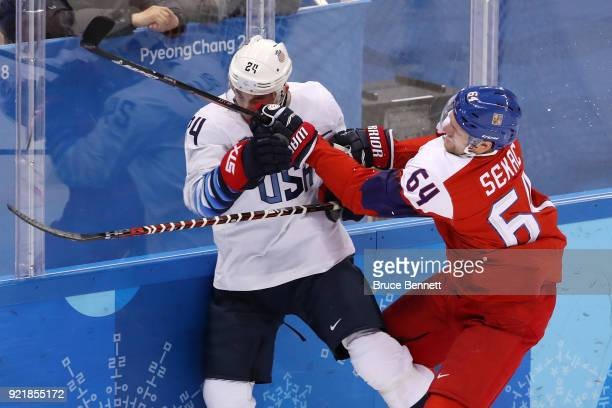 Jonathon Blum of the United States collides with Jiri Sekac of the Czech Republic in the first period during the Men's Playoffs Quarterfinals on day...