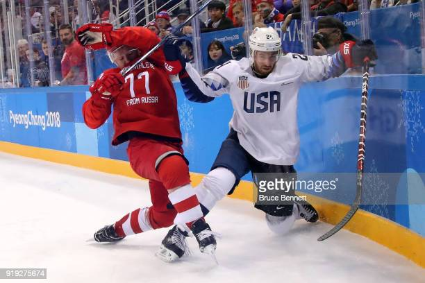 Jonathon Blum of the United States gets knocked down against Kirill Kaprizov of Olympic Athlete from Russia during the Men's Ice Hockey Preliminary...