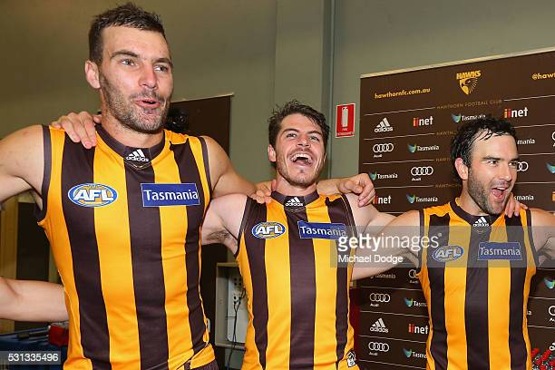 Jonathon Ceglar Isaac Smith and Jordan Lewis of the Hawks sing the club song after winning during the round eight AFL match between the Hawthorn...