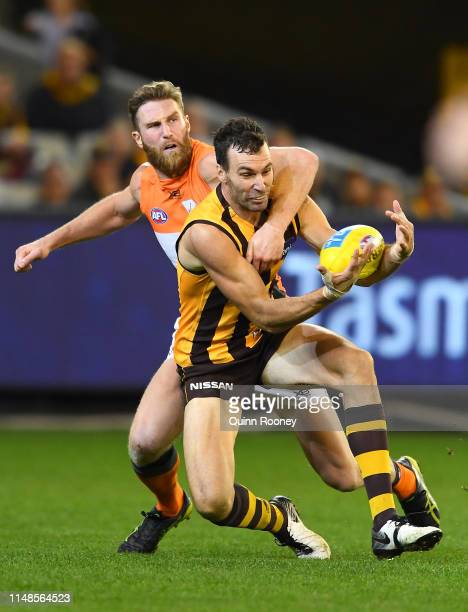 Jonathon Ceglar of the Hawks marks infront of Dawson Simpson of the Giants during the round eight AFL match between the Hawthorn Hawks and the...
