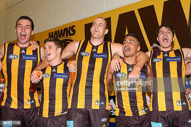 Jonathon Ceglar Taylor Duryea David Hale Bradley Hill and Isaac Smith of the Hawks sing the song in the rooms after winning the round three AFL match...