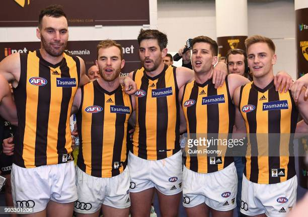 Jonathon Ceglar Tom Mitchell Ricky Henderson Luke Breust and Harry Morrison of the Hawks sing the song in the rooms after winning the round 16 AFL...