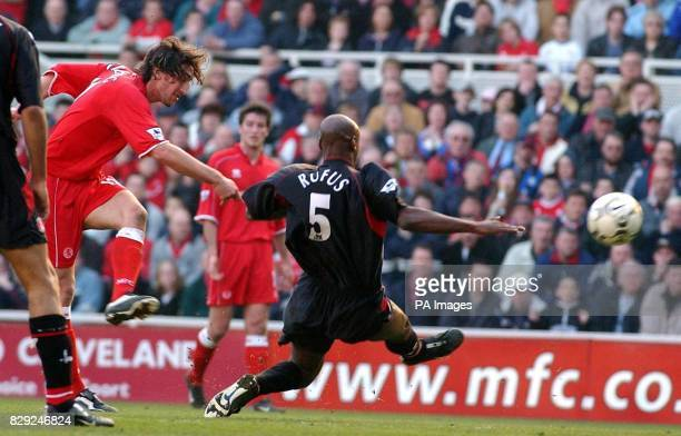 Jonathon Greening of Middlesbrough shoots past Charlton's Richard Rufus during the Barclaycard Premiership match at The Riverside Stadium...