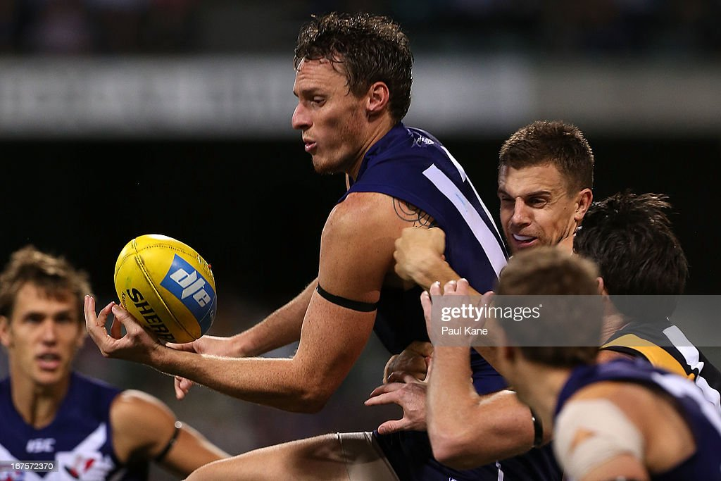 Jonathon Griffin of the Dockers handballs during the round five AFL match between the Fremantle Dockers and the Richmond Tigers at Patersons Stadium on April 26, 2013 in Perth, Australia.
