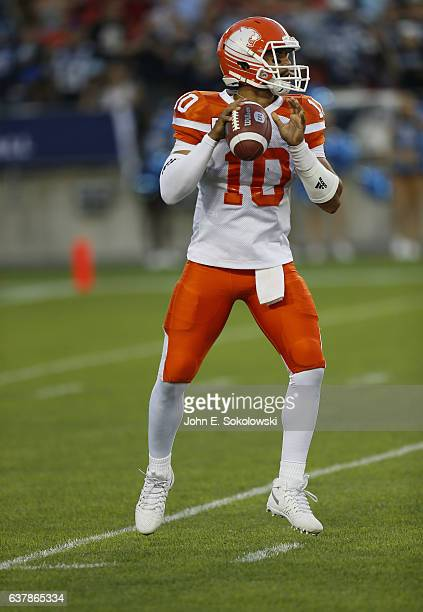 Jonathon Jennings of the BC Lions sets up to throw a pass against the Toronto Argonauts during a CFL game at BMO field on August 31 2016 in Toronto...