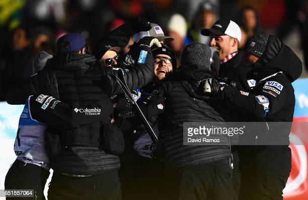 Jonathon Lillis of the United States celebrates with coaching staff and team mates during the Men's Aerials Final on day three of the FIS Freestyle...