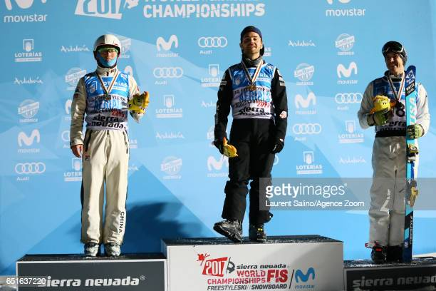 Jonathon Lillis of USA wins the gold medal Guangpu Qi of China wins the silver medal David Morris of Australia wins the bronze medal during the FIS...