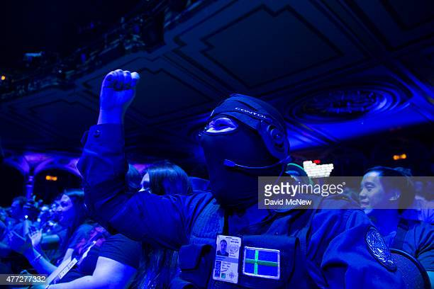 Jonathon Lundkvist dressed as a character from Tom Clancy's The Division reacts to a presentation at the Ubisoft E3 Conference on June 15 2015 in Los...