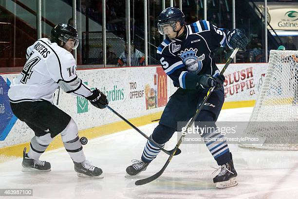 Jonathon Masters of the Gatineau Olympiques defends against Nicolas Roy of the Chicoutimi Sagueneens on February 20 2015 at Robert Guertin Arena in...
