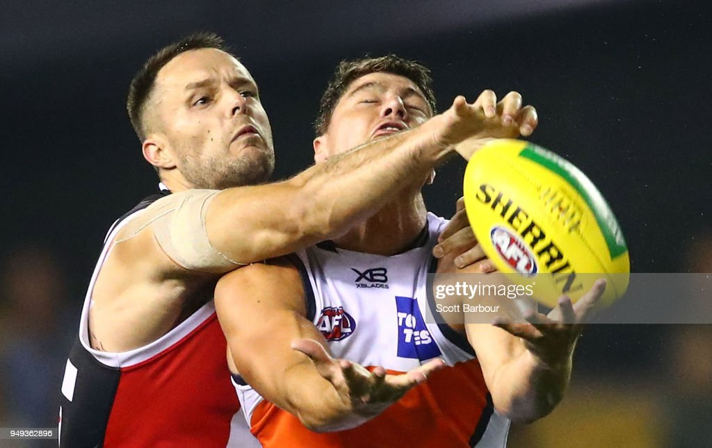 Jonathon Patton of the Giants and Nathan Brown of the Saints compete for the ball during the round five AFL match between the St Kilda Saints and the Greater Western Sydney Giants at Etihad Stadium on April 21, 2018 in Melbourne, Australia.