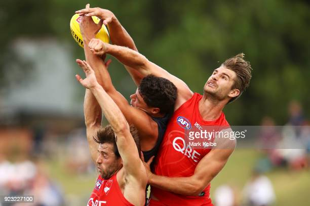Jonathon Patton of the Giants attempts to mark under pressure from Nick Smith and Harrison Marsh of the Swans during the AFL Inter Club match between...