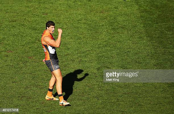 Jonathon Patton of the Giants celebrates a goal during the round 14 AFL match between the Greater Western Sydney Giants and the Carlton Blues at...