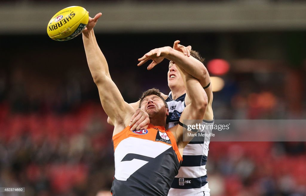 Jonathon Patton of the Giants competes for the ball against Hamish McIntosh of the Cats during the round 18 AFL match between the Greater Western Sydney Giants and the Geelong Cats at Spotless Stadium on July 19, 2014 in Sydney, Australia.