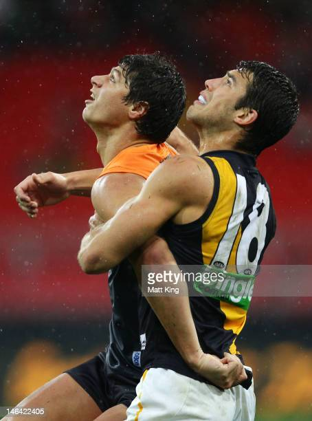 Jonathon Patton of the Giants competes with Alex Rance of the Tigers during the round 12 AFL match between the Greater Western Sydney Giants and the...