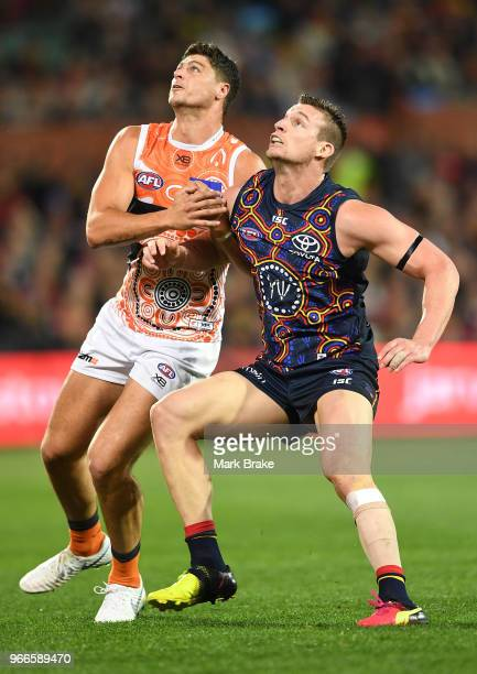Jonathon Patton of the Giants competes with Josh Jenkins of the Adelaide Crows during the round 11 AFL match between the Adelaide Crows and the...