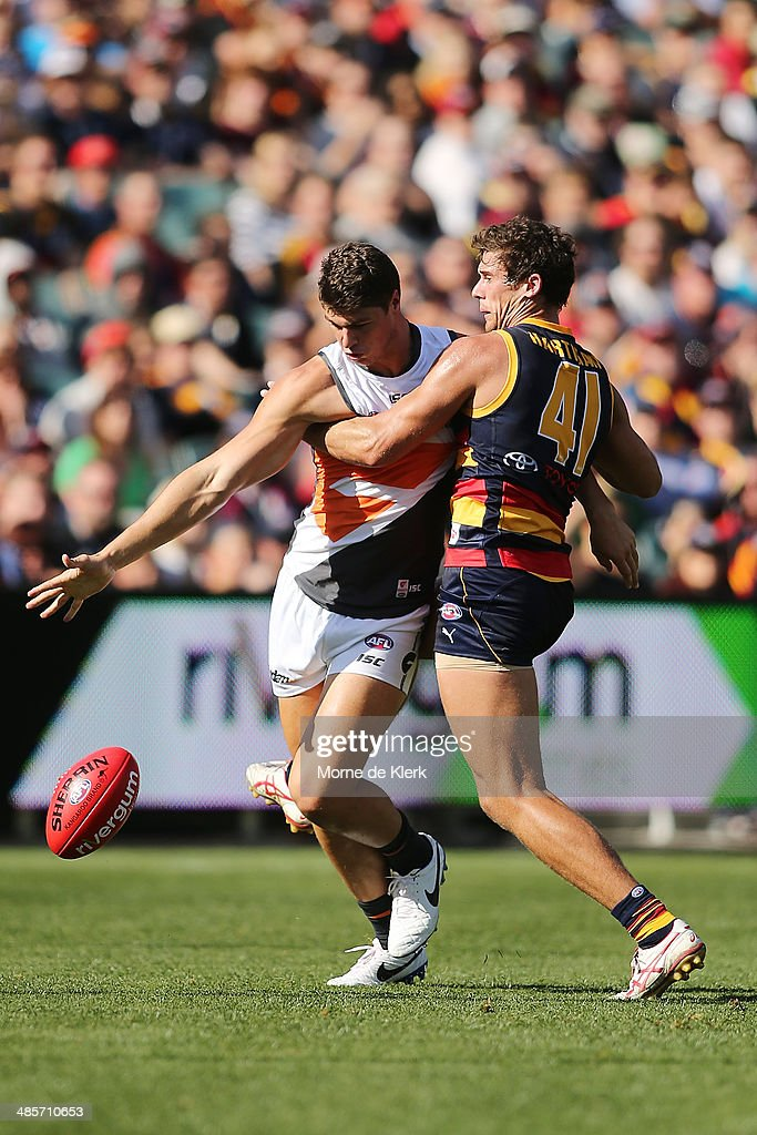 Jonathon Patton of the Giants competes with Kyle Hartigan of the Crows during the round five AFL match between the Adelaide Crows and the Greater Western Sydney Giants at Adelaide Oval on April 20, 2014 in Adelaide, Australia.